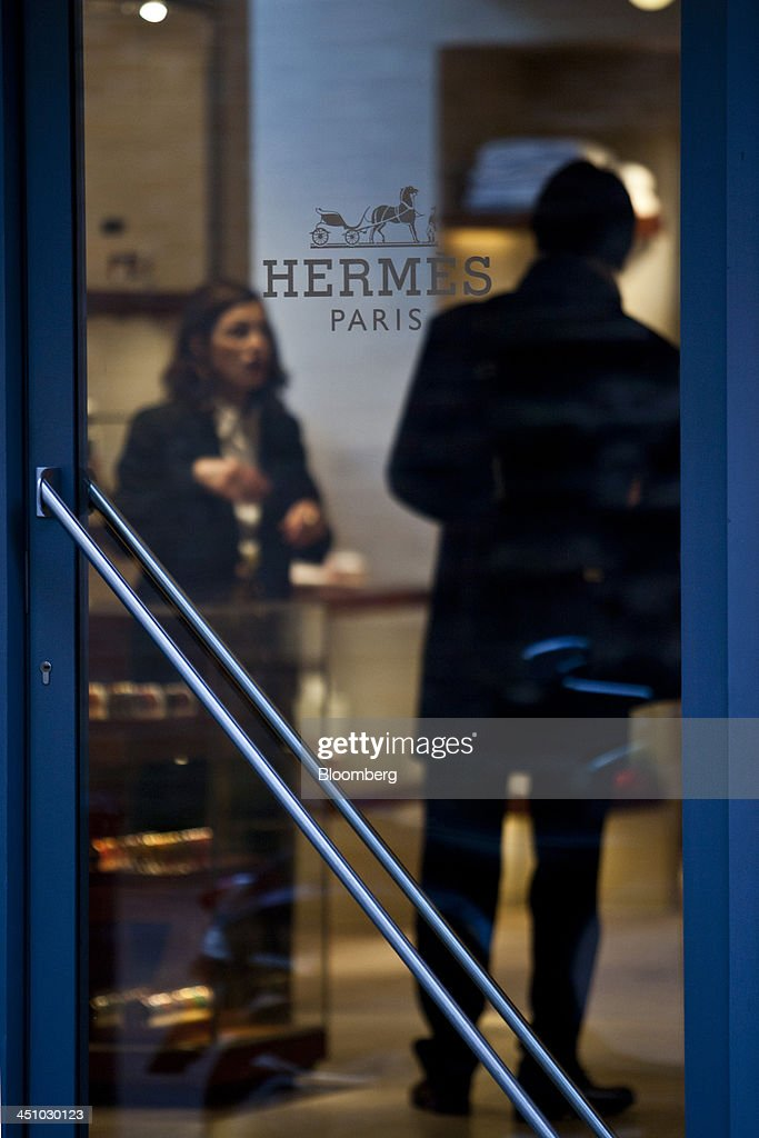 A logo sits on a door of a luxury fashion clothing store operated by Hermes International SCA in Toulouse, France, on Wednesday, Nov. 20, 2013. France's gross domestic product fell 0.1 percent in the three months through September, national statistics office Insee said in an e-mailed statement. Photographer: Balint Porneczi/Bloomberg via Getty Images