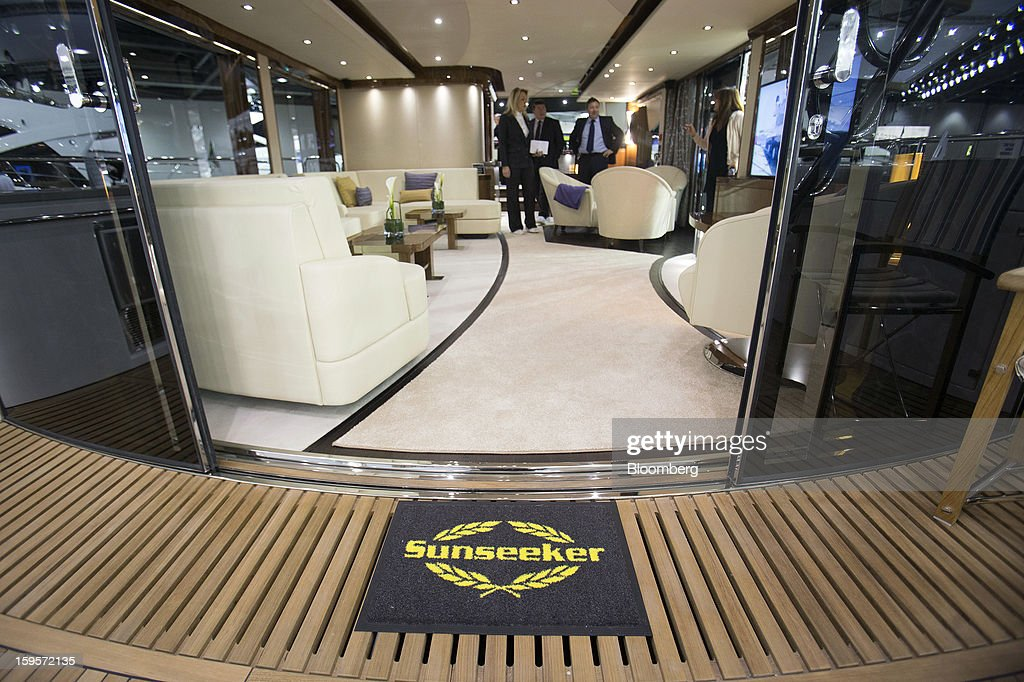 A logo sits on a doormat as visitors are shown around the interior of a luxury yacht, manufactured by Sunseeker International Ltd., during the Tullet Prebon London Boat Show 2013 at the ExCeL center in London, U.K., on Wednesday, Jan. 16, 2013. The show, Europe's first in 2013, will showcase new sailing craft from dinghies to luxury yachts, and runs Jan. 12-20. Photographer: Simon Dawson/Bloomberg via Getty Images