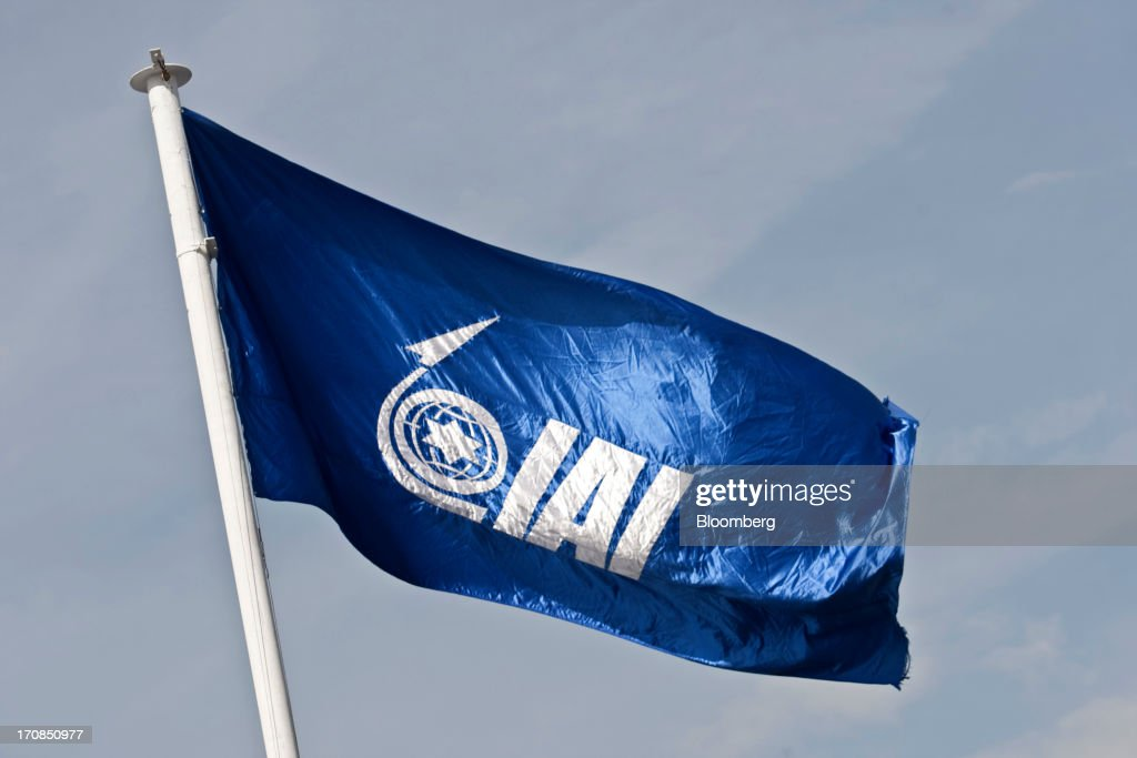 A logo sits on a flag as it flies above Israel Aerospace Industries Ltd.'s (IAI) display stand on the second day of the Paris Air Show in Paris, France, on Tuesday, June 18, 2013. The 50th International Paris Air Show is the world's largest aviation and space industry show, and takes place at Le Bourget airport June 17-23. Photographer: Balint Porneczi/Bloomberg via Getty Images