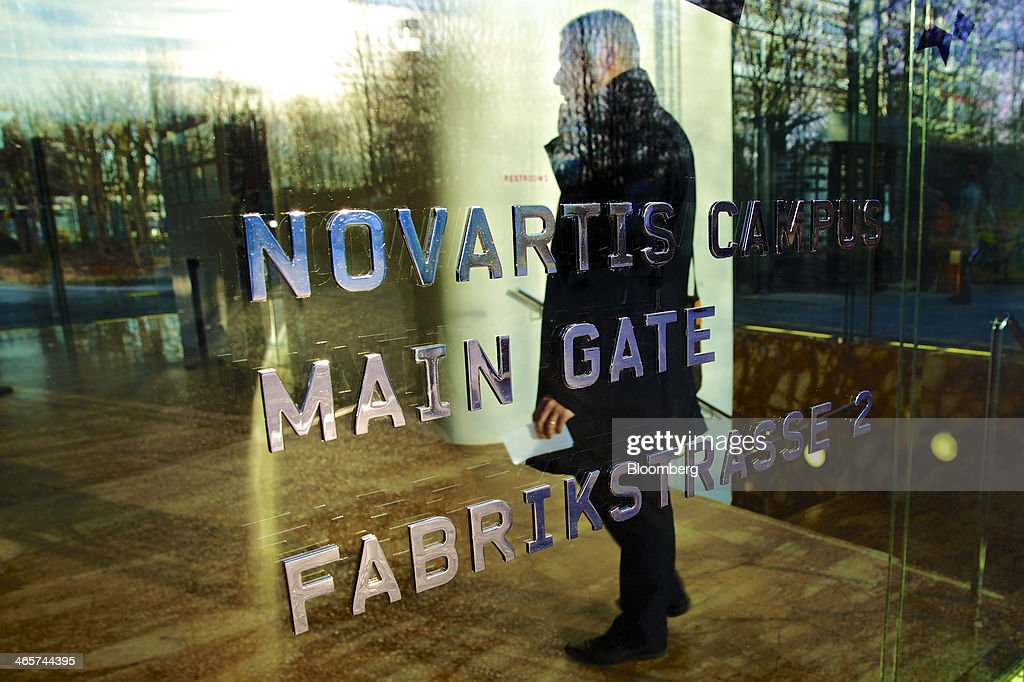 A logo sits on a glass door outside Novartis AG's headquarters in Basel, Switzerland, on Wednesday, Jan. 29, 2014. Novartis AG, Europe's biggest drugmaker by sales, said fourth-quarter profit fell as currencies in emerging markets weakened against the dollar. Photographer: Gianluca Colla/Bloomberg via Getty Images
