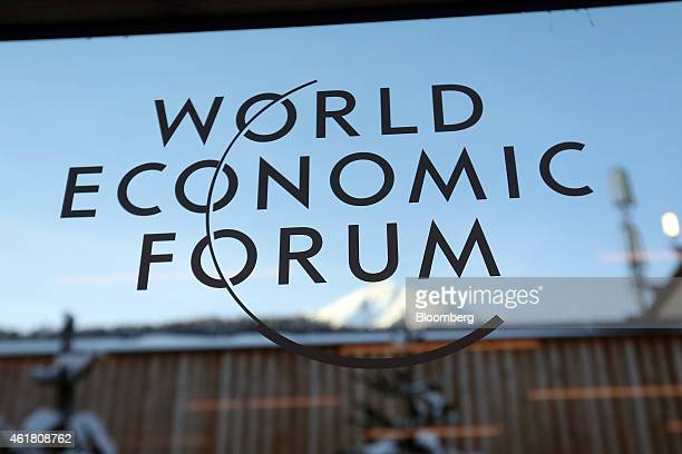 A logo sits on a glass panel inside the Kongress Zentrum also known as Congress Center the venue of the World Economic Forum in Davos Switzerland on...