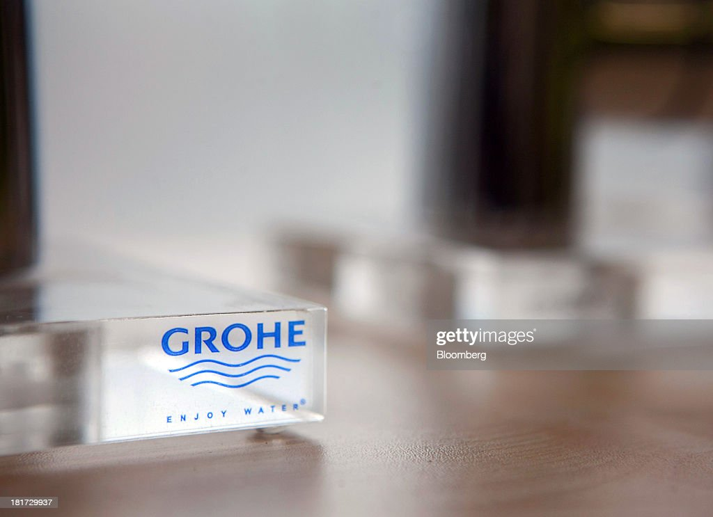 A logo sits on a perspex display block for bathroom-fixtures company Grohe Group inside a bathroom store in Berlin, Germany, on Tuesday, Sept. 24, 2013. Lixil Corp., a Japanese toilet maker, is in advanced talks to buy German bathroom-fixtures company Grohe Group for more than 3 billion euros ($4 billion), according to people with knowledge of the matter. Photographer: Krisztian Bocsi/Bloomberg via Getty Images