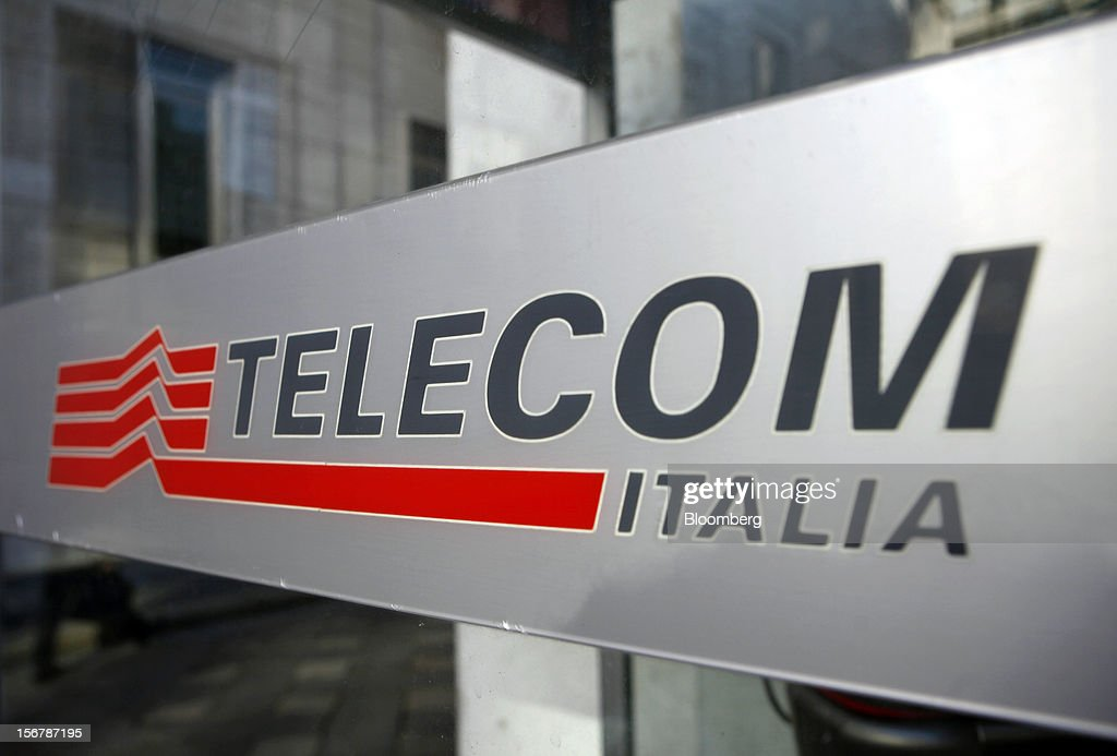 A logo sits on a public telephone booth operated by Telecom Italia SpA, in Milan, Italy, on Tuesday, Nov. 20, 2012. Telecom Italia SpA said it is still reviewing the possible spinoff of its fixed-line network and the company's board will discuss the outcome of its analysis on Dec. 6. Photographer: Alessia Pierdomenico/Bloomberg via Getty Images