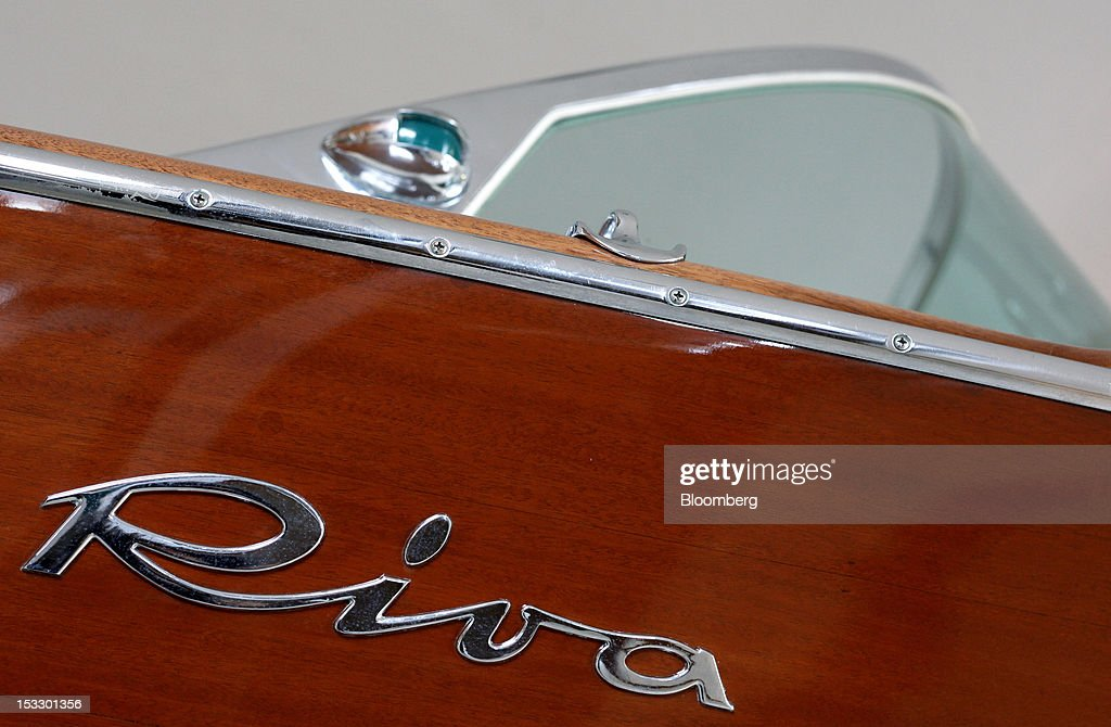A logo sits on a Riva 'Super Ariston' boat, circa 1960, inside the company's offices in Sarnico, Italy, on Tuesday, Oct. 2, 2012. Ferretti Group, whose Riva unit made boats for Brigitte Bardot and Sean Connery, intends to open an assembly plant in China as its new Chinese parent, Shandong Heavy, seeks to drive up sales in the world's most-populous country. Photographer: Alessia Pierdomenico/Bloomberg via Getty Images