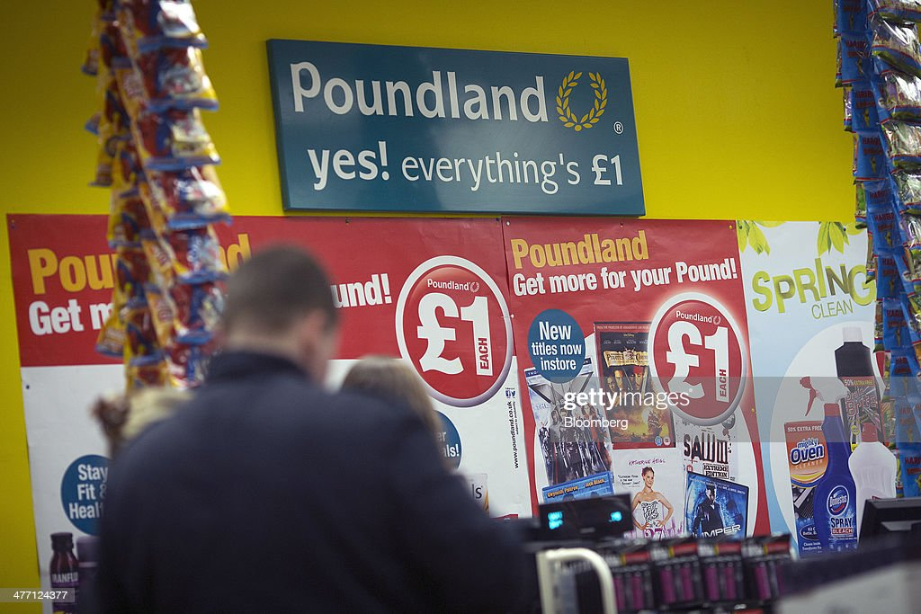 A logo sits on a sign above a check-out desk inside a Poundland discount store, operated by Poundland Group Plc in London, U.K., on Friday, March 7, 2014. Poundland Group Plc has demand for all the shares it is selling in an initial public offering that will value the U.K. discount retailer at as much as 750 million pounds ($1.3 billion), according to terms of the deal. Photographer: Simon Dawson/Bloomberg via Getty Images