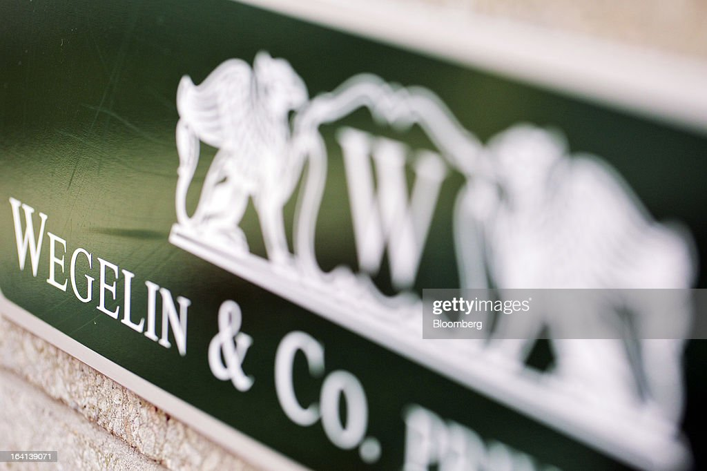 A logo sits on a sign at the entrance to Wegelin & Co.'s offices in Zurich, Switzerland, on Wednesday, March 20, 2013. Wegelin & Co. were ordered to pay U.S. authorities almost $58 million at the end of a criminal case after the Swiss bank pleaded guilty to helping American taxpayers hide more than $1.2 billion from the Internal Revenue Service. Photographer: Gianluca Colla/Bloomberg via Getty Images