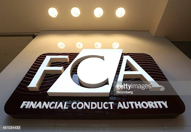 A logo sits on a sign in the reception area of the headquarters of the Financial Conduct Authority in London UK on Thursday Nov 21 2013 The FCA is...