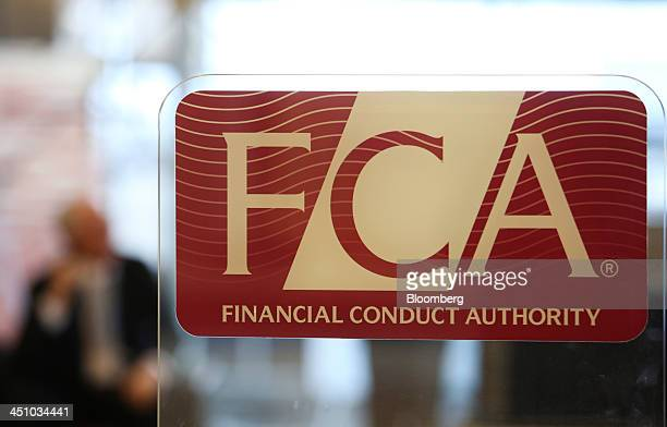 A logo sits on a sign in the reception area of the headquarters of the Financial Conduct Authority in the Canary Wharf business district in London UK...