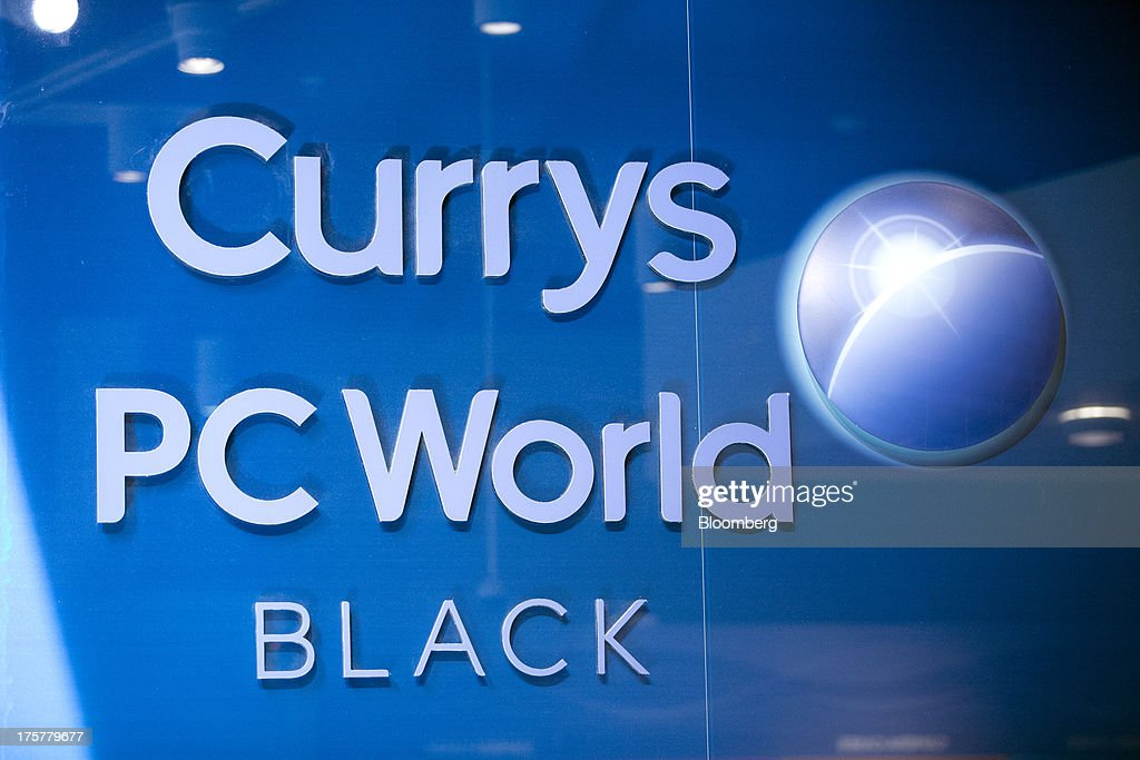 A logo sits on a sign inside a Currys and PC World 2 in 1 store, operated by Dixons Retail Plc, at the Westfield Stratford City retail complex in London, U.K., on Thursday, Aug. 8, 2013. U.K. consumer confidence rose to the highest in more than three years as Britons' optimism about the economic outlook improved. Photographer: Simon Dawson/Bloomberg via Getty Images