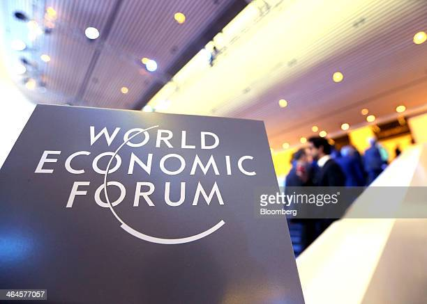 A logo sits on a sign inside the Congress Center on day two of the World Economic Forum in Davos Switzerland on Thursday Jan 23 2014 World leaders...