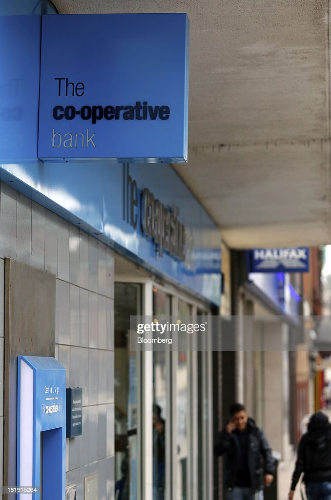 A logo sits on a sign outside a Co-Operative Bank Plc branch, a unit of Co-Operative Group Ltd., in Bolton, U.K., on Wednesday, Sept. 25, 2013. The parent of Co-operative Bank, which is seeking capital after losses, may avoid being forced to rescue the lender thanks to an accord it struck with regulators last year, according to bondholders. Photographer: Paul Thomas/Bloomberg via Getty Images