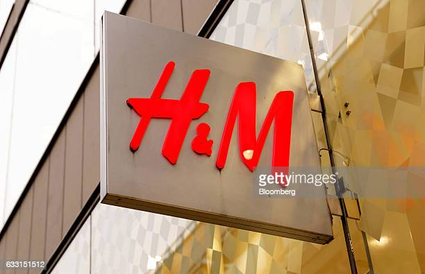A logo sits on a sign outside a Hennes Mauritz AB fashion retail store in Stockholm Sweden on Tuesday Jan 31 2017 Hennes Mauritz AB provided some...