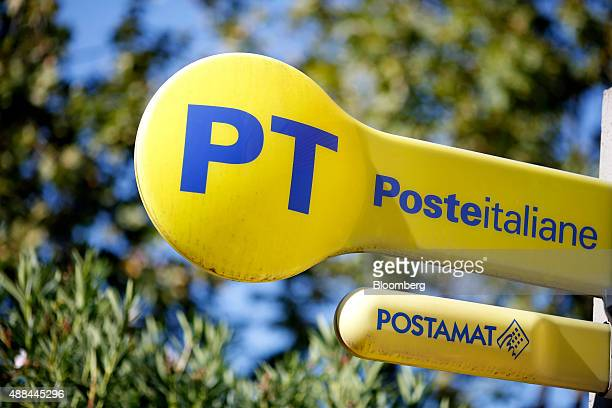 A logo sits on a sign outside a Poste Italiane SpA post office in Rome Italy on Thursday Sept 10 2015 Italy is proceeding with a plan to sell as much...