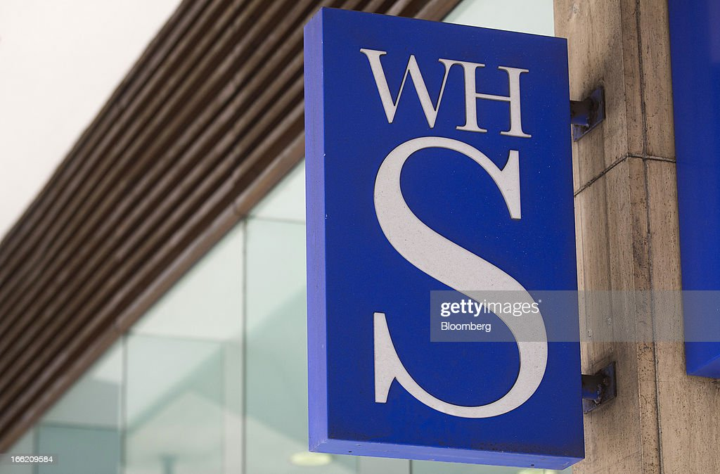 A logo sits on a sign outside a WH Smith Plc store in London, U.K., on Wednesday, April 10, 2013. WH Smith Plc, the book and magazine retailer with more than 1,100 U.K. outlets, is scheduled to announce earnings on April 11. Photographer: Simon Dawson/Bloomberg via Getty Images