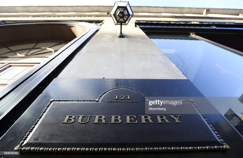 A logo sits on a sign outside Burberry Group Plc's luxury clothing store on Regent Street in London, U.K., on Tuesday, Oct. 15, 2013. Burberry named Christopher Bailey as chief executive officer to succeed Angela Ahrendts who will leave in 2014 to work as a senior vice president at Apple Inc. Photographer: Chris Ratcliffe/Bloomberg via Getty Images