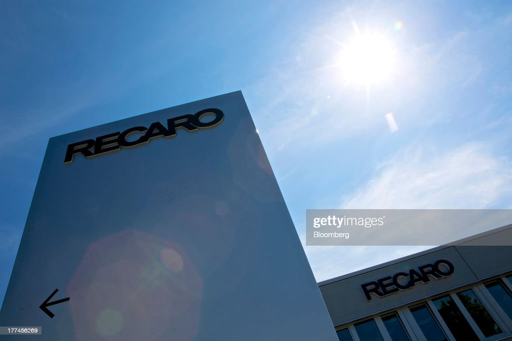 A logo sits on a sign outside Recaro Aircraft Seating GmbH & Co.'s assembly plant in Schwabish Hall, Germany, on Thursday, Aug. 22, 2013. Germany's economic growth in the second quarter was driven by consumption and a rebound in investment as a recovery in the 17-nation euro area, its biggest trading partner, bolstered confidence. Photographer: Gianluca Colla/Bloomberg via Getty Images