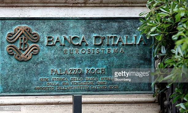 A logo sits on a sign outside the Banca D'Italia Italy's central bank in Rome Italy on Sunday May 5 2013 Italian banks' corporate loan book will...