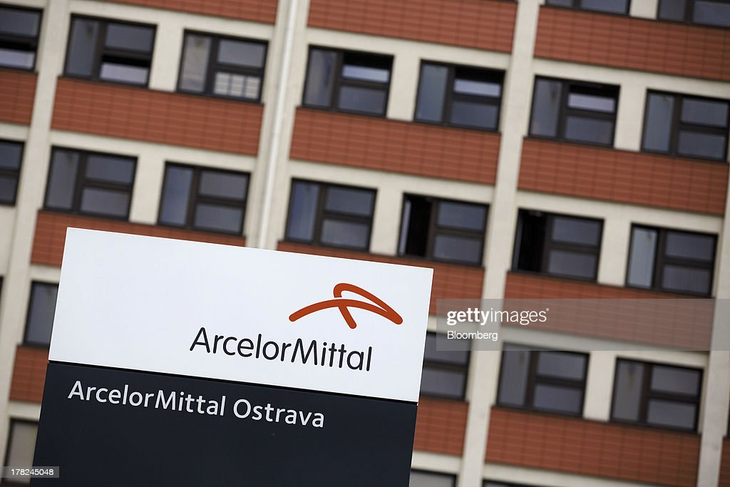 A logo sits on a sign outside the entrance to the ArcelorMittal steel plant in Ostrava, Czech Republic, on Monday, Aug. 26, 2013. ArcelorMittal, the world's biggest steelmaker, said steel shipments will rise 1 percent to 2 percent this year compared with an earlier forecast of 2 percent in May. Photographer: Martin Divisek/Bloomberg via Getty Images