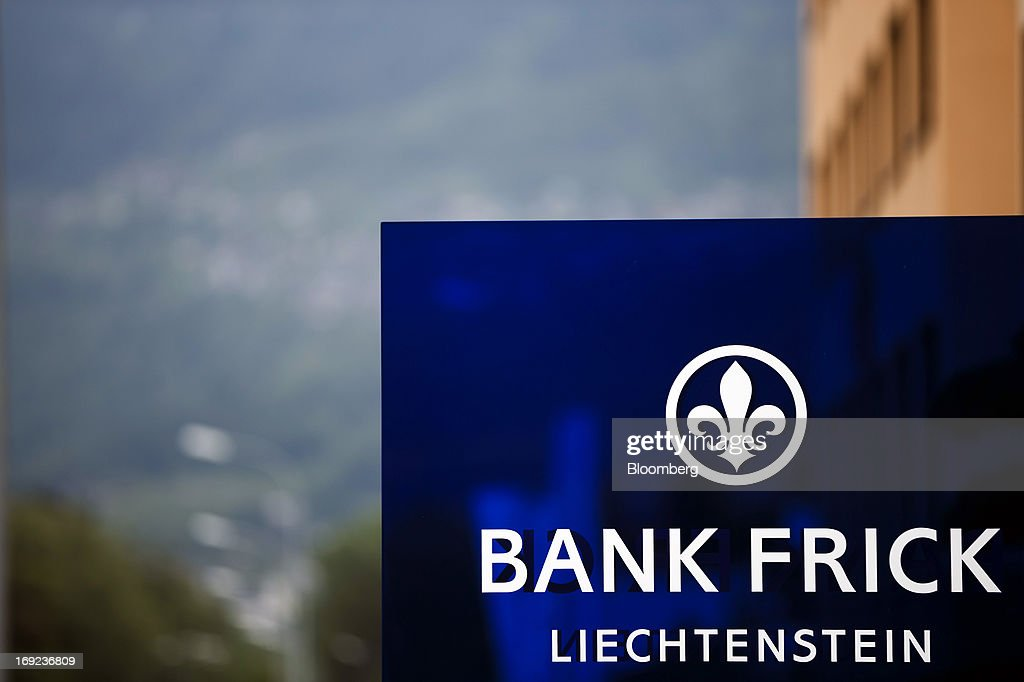 A logo sits on a sign outside the headquarters of Bank Frick & Co. AG in Balzers near Vaduz, Liechtenstein, on Tuesday, May 21, 2013. Liechtenstein, an alpine principality once fabled for its banking secrecy laws, remains a place favored by billionaires to stash the holding companies and investment entities that control their assets. Photographer: Valentin Flauraud/Bloomberg via Getty Images