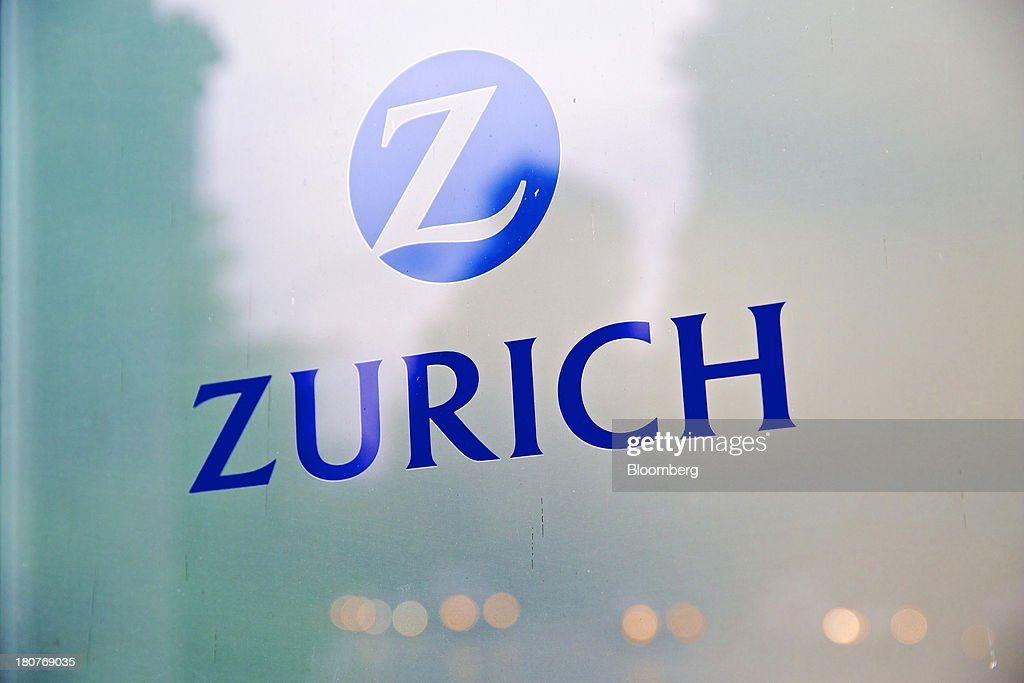 A logo sits on a sign outside Zurich Insurance Group AG's headquarters in Zurich, Switzerland, on Monday, Sept. 16, 2013. Zurich Insurance named Tom de Swaan chairman, replacing Josef Ackermann, who stepped down after the suicide of Chief Financial Officer Pierre Wauthier. Photographer: Gianluca Colla/Bloomberg via Getty Images