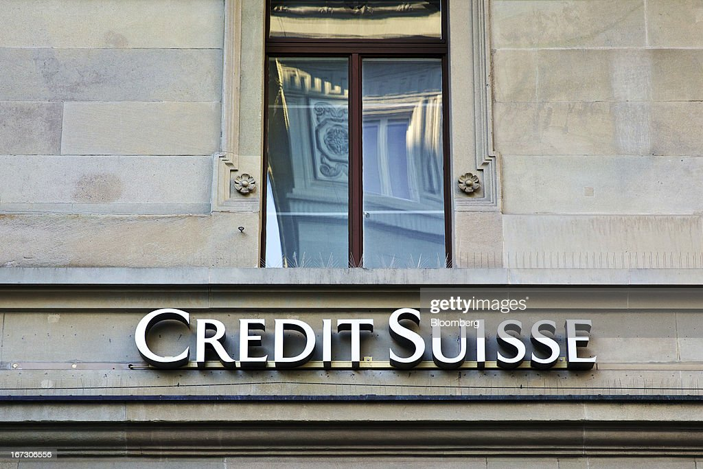 A logo sits on a wall above the entrance to a Credit Suisse Group AG bank branch in Zurich, Switzerland, on Wednesday, April 24, 2013. Credit Suisse Group AG, the second- biggest Swiss bank, posted a jump in first-quarter profit as year-earlier charges related to its own debt and bonus payments weren't repeated. Photographer: Gianluca Colla/Bloomberg via Getty Images