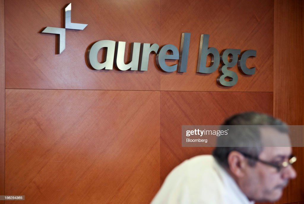 A logo sits on a wall inside Aurel BGC's brokerage in Paris, France, on Monday, Nov. 12, 2012. European stocks fluctuated between gains and losses as finance ministers prepared to discuss Greek aid after the country's lawmakers approved the 2013 budget. Photographer: Balint Porneczi/Bloomberg via Getty Images