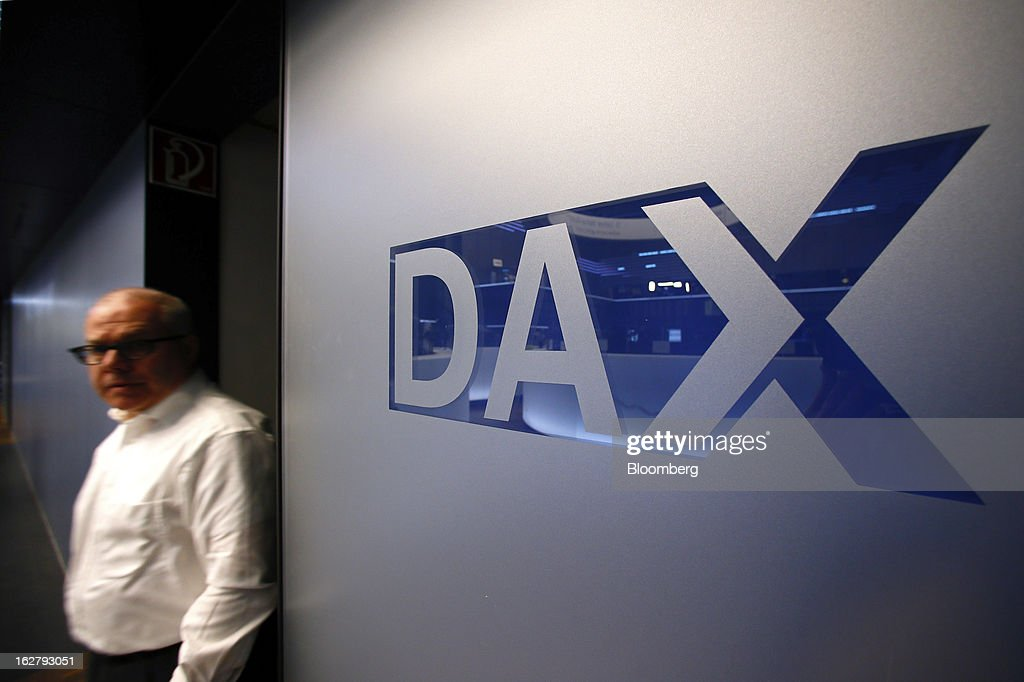 A DAX logo sits on a wall inside the Frankfurt Stock Exchange in Frankfurt, Germany, on Tuesday, Feb. 27, 2013. Stocks rose, the euro strengthened from a seven-week low and Italian 10-year bonds gained after the country sold 6.5 billion euros ($8.5 billion) of debt amid political turmoil. Photographer: Ralph Orlowski/Bloomberg via Getty Images