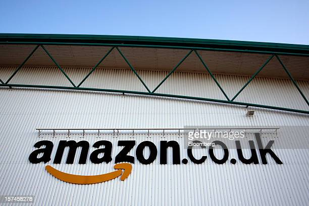 A logo sits on a wall outside the Amazoncouk Marston Gate 'Fulfillment Center' the UK site of Amazoncom Inc in Ridgmont UK on Monday Dec 3 2012 UK...