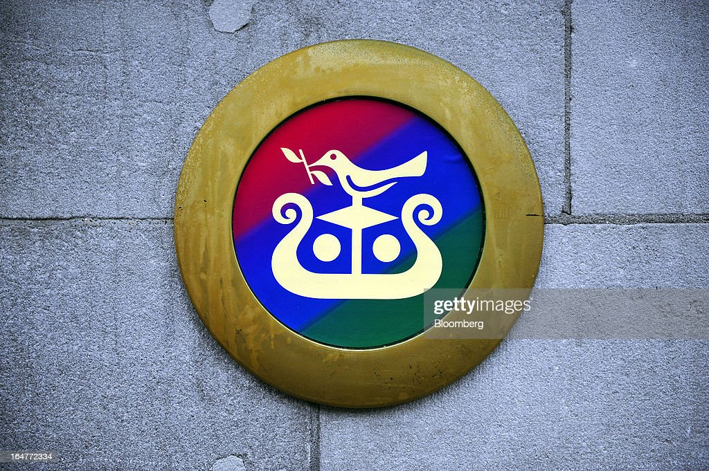 A logo sits on a wall outside the entrance to an Allied Irish Banks Plc (AIB) branch in Dublin, Ireland, on Wednesday, March 27, 2013. Allied Irish Banks Plc, which cost taxpayers about 21 billion euros ($27 billion) to rescue, said its annual loss widened as a decline in bad loan losses failed to offset dwindling gains from buying back its own debt. Photographer: Aidan Crawley/Bloomberg via Getty Images
