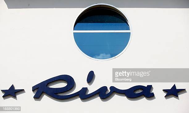 A logo sits on a wall outside the Riva shipyard in Sarnico Italy on Tuesday Oct 2 2012 Ferretti Group whose Riva unit made boats for Brigitte Bardot...