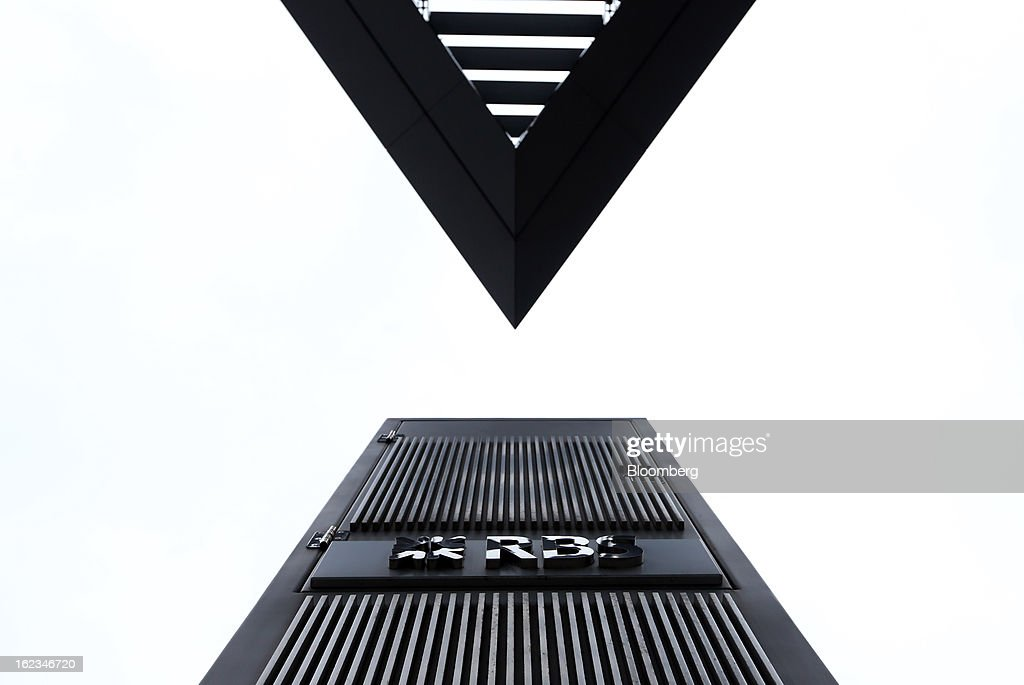 A logo sits on a wall outside the Royal Bank of Scotland Group Plc's (RBS) headquarters in London, U.K., on Friday, Feb. 22, 2013. RBS, Britain's biggest publicly owned lender, was fined $612 million by regulators in the U.K. and the U.S. for rigging the London interbank offered rate and similar benchmarks. Photographer: Chris Ratcliffe/Bloomberg via Getty Images