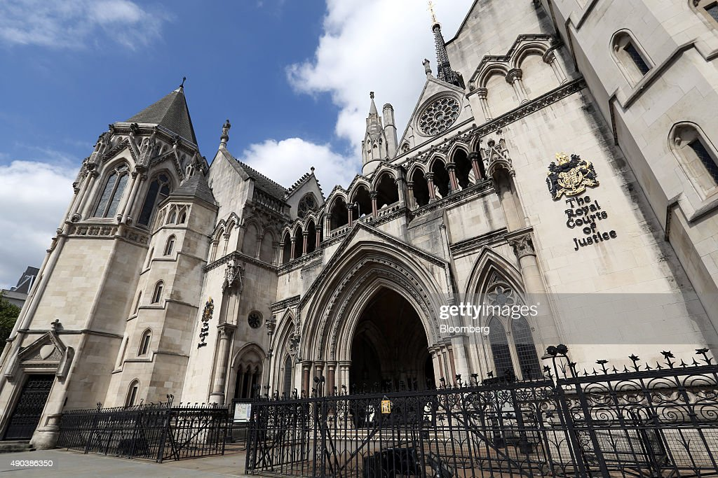 A logo sits on a wall outside the Royal Courts of Justice in London UK on Tuesday Sept 2 2014 Photographer Chris Ratcliffe/Bloomberg via Getty Images