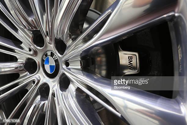 A BMW logo sits on a wheel hub of a BMW 7Series automobile manufactured by Bayerische Motoren Werke AG inside the BMW World showroom in Munich...