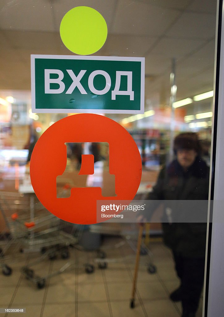 A logo sits on a window at a supermarket operated by OAO Dixy Group in Moscow, Russia, on Friday, Feb. 22, 2013. Russia's largest retailer by market value, OAO Magnit, is spending as much as $1.8 billion this year to compete against X5 Retail Group NV and OAO Dixy Group. Photographer: Andrey Rudakov/Bloomberg via Getty Images