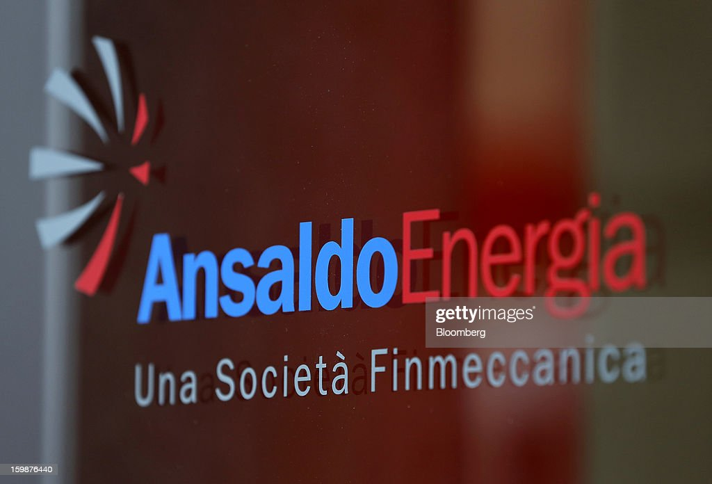 A logo sits on a window at Ansaldo Energia SpA's power-plant production facility in Genoa, Italy, on Friday, Jan. 18, 2013. Finmeccanica SpA is seeking binding bids for assets, including a majority stake in Ansaldo Energia, by Jan. 23, while a final decision will be made at a later board meeting, Ansa reported Jan. 16. Photographer: Alessia Pierdomenico/Bloomberg via Getty Images