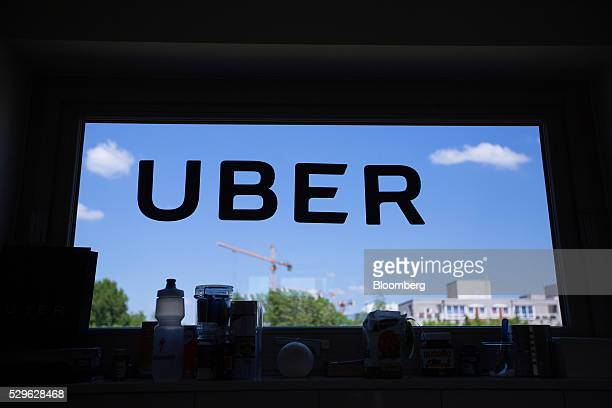 A logo sits on a window inside the offices of Uber Technologies Inc at Factory Berlin tech hub in Berlin Germany on Monday May 9th 2016 Uber will...