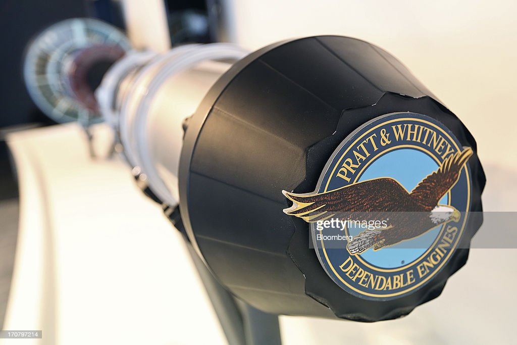 A logo sits on an aircraft engine display on the the Pratt & Whitney's stand, a unit of United Technologies Corp., on the second day of the Paris Air Show in Paris, France, on Tuesday, June 18, 2013. The 50th International Paris Air Show is the world's largest aviation and space industry show, and takes place at Le Bourget airport June 17-23. Photographer: Chris Ratcliffe/Bloomberg via Getty Images