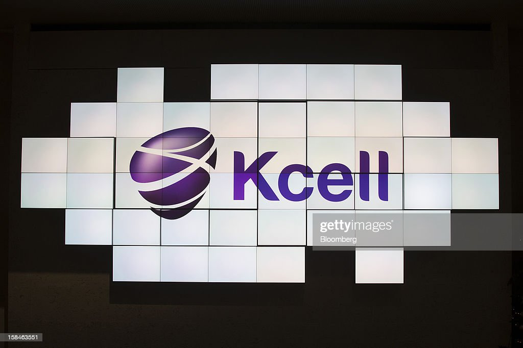 A logo sits on an electronic display screen during the initial public offering (IPO) launch of Kcell, a unit of TeliaSonera AB, at the London Stock Exchange in London, U.K., on Monday, Dec. 17, 2012. Kcell, which has 11.6 million subscribers, is the largest operator in Kazakhstan with a subscriber market share of about 48 percent and a revenue market share of 57 percent, Chief Executive Officer Veysel Aral said. Photographer: Simon Dawson/Bloomberg via Getty Images