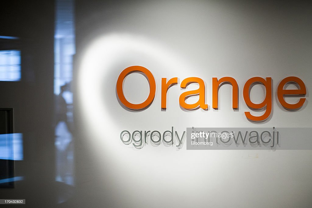 A logo sits on display at the headquarters of Orange Polska, also known as Telekomunikacja Polska SA (TPSA), Poland's national telecommunications company, in Warsaw, Poland, on Wednesday, June 12, 2013. Cable providers are being drawn to Poland, the European Union's biggest eastern economy, because penetration levels are half that of neighboring Germany even as unemployment rises, according to a website presentation by the country's biggest TV network, Cyfrowy Polsat SA. Photographer: Bartek Sadowski/Bloomberg via Getty Images