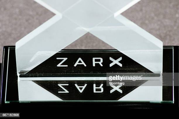 A logo sits on display at the ZAR X South Africa's second stock exchange in Johannesburg South Africa on Tuesday April 11 2017 ZAR X became the first...
