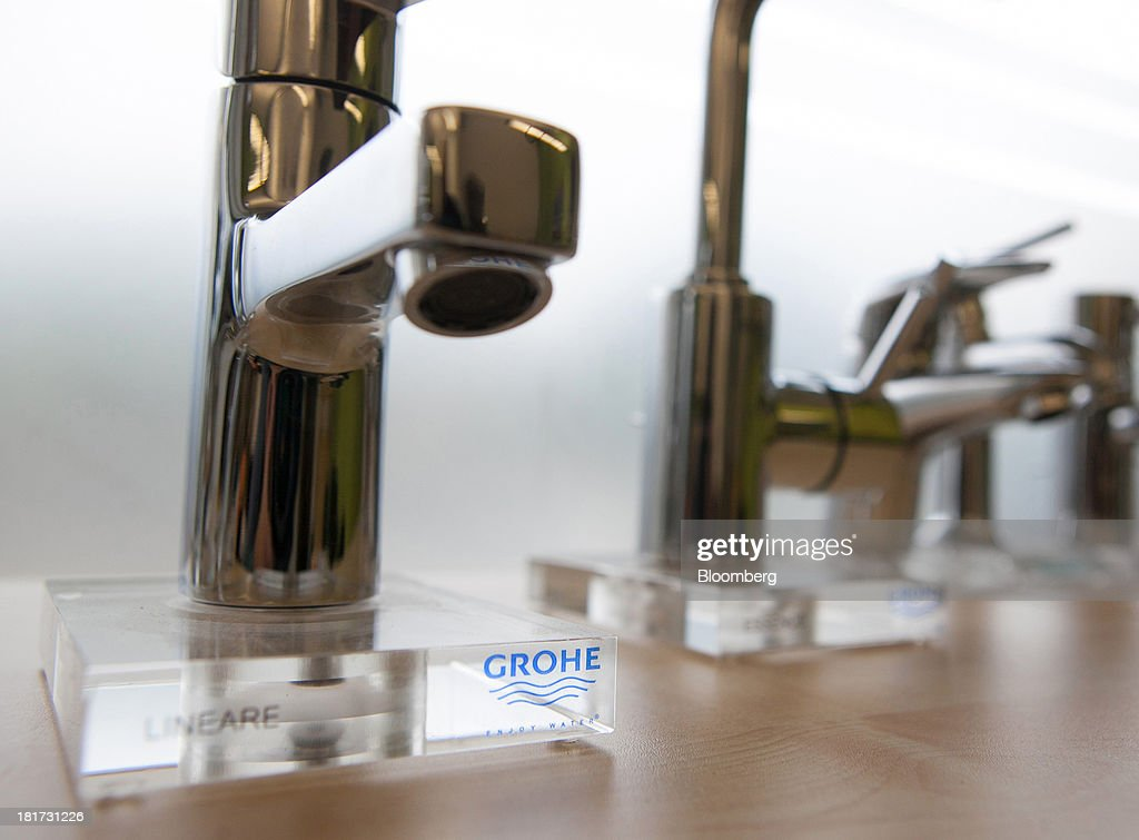 A logo sits on display beneath a bathroom tap, manufactured by Grohe Group, inside a bathroom store in Berlin, Germany, on Tuesday, Sept. 24, 2013. Lixil Corp., a Japanese toilet maker, is in advanced talks to buy German bathroom-fixtures company Grohe Group for more than 3 billion euros ($4 billion), according to people with knowledge of the matter. Photographer: Krisztian Bocsi/Bloomberg via Getty Images