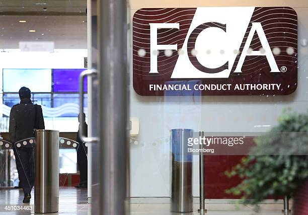 A logo sits on display in the headquarters of the Financial Conduct Authority in the Canary Wharf business district in London UK on Thursday Nov 21...