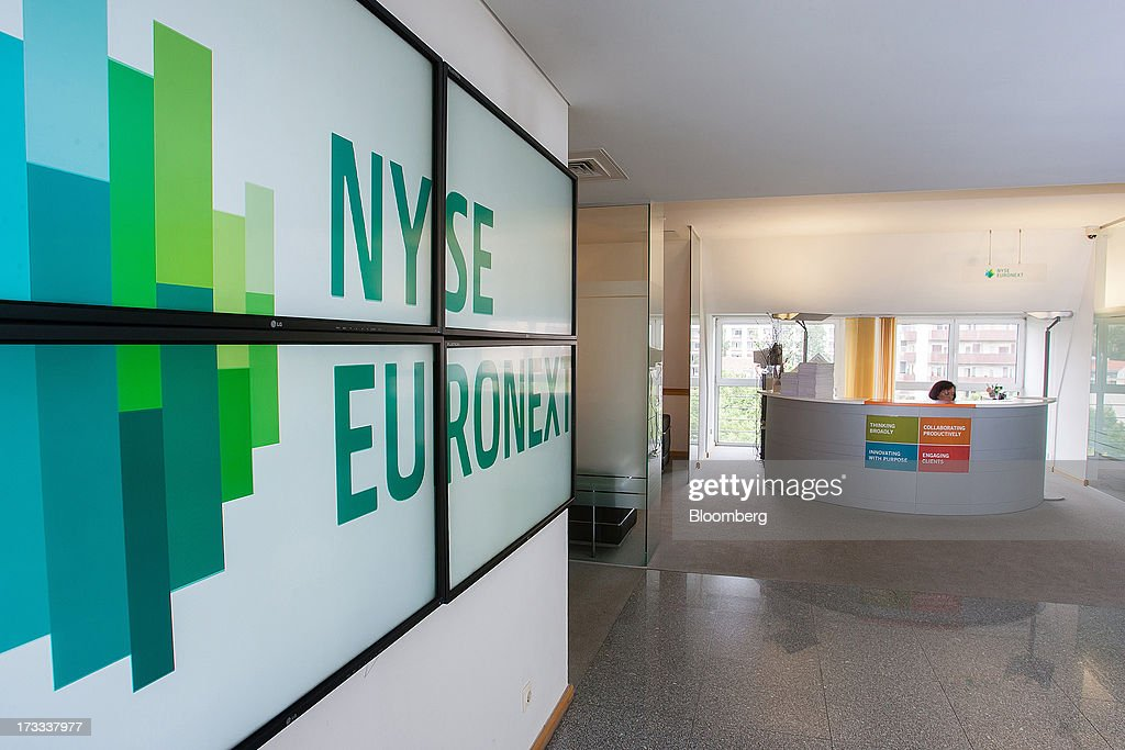 A logo sits on display in the reception area of the NYSE Euronext Lisbon stock exchange in Lisbon, Portugal, on Thursday, July 11, 2013. NYSE Euronext, whose Liffe exchange is the biggest market for short-term interest rate derivatives, is vowing to restore confidence in the London benchmark Libor at the heart of the financial world's biggest scandal. Photographer: Mario Proenca/Bloomberg via Getty Images