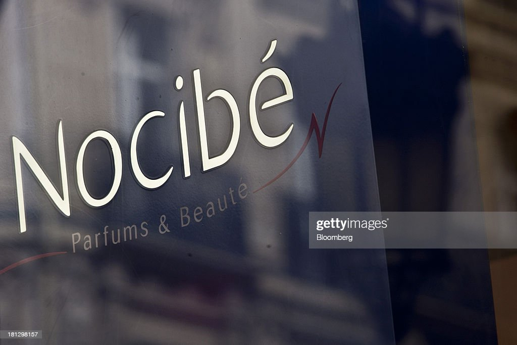 A logo sits on display in the window of a Nocibe SA beauty store in Paris, France, on Thursday, Sept. 19, 2013. Bank of France General Council member Bernard Maris said France will end up restructuring its debt as tax 'optimization' by large companies including Google Inc. will leave too big a burden on the middle class. Photographer: Balint Porneczi/Bloomberg via Getty Images