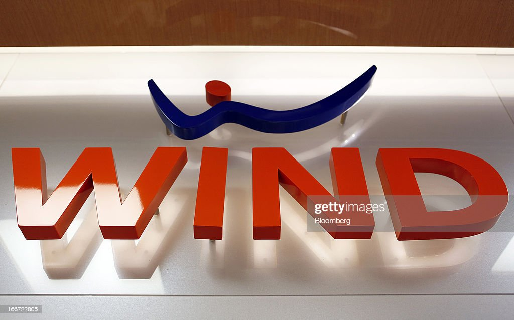 A logo sits on display inside a Wind SpA mobile phone store, owned by VimpelCom Ltd., in Rome, Italy, on Monday, April 15, 2013. Italy's state-owned postal service and Wind SpA, the country's third-largest mobile-phone company, are discussing a possible venture with Wind's fixed-line network Infostrada, Poste Italiane SpA Chief Executive Officer Massimo Sarmi said. Photographer: Alessia Pierdomenico/Bloomberg via Getty Images