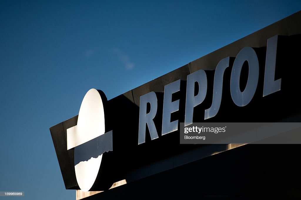A logo sits on display on the roof of a Repsol SA gas station in Puigdalbert, near Barcelona, Spain, on Wednesday, Jan. 23, 2013. Repsol SA, Spain's largest energy company, expects to sell liquefied natural gas assets for about 2 billion euros ($2.7 billion) by early February, according to a person familiar with the matter. Photographer: David Ramos/Bloomberg via Getty Images