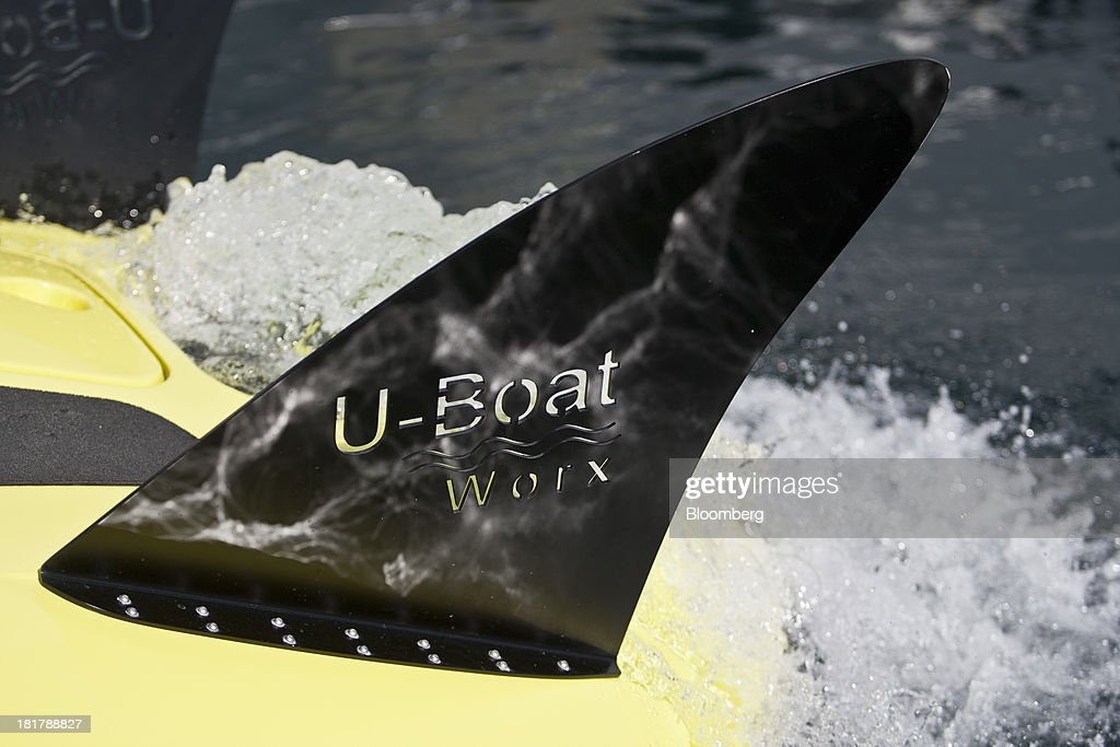 A logo sits on display on the tail fin of a C-Quester 3 submarine during the Monaco Yacht Show (MYS) in the harbor in Monaco, France, on Wednesday, Sept. 25, 2013. Over 100 of the world's luxury yachts will be displayed in Port Hercules during the 23rd MYS which runs from Sept. 25 - 28. Photographer: Balint Porneczi/Bloomberg via Getty Images