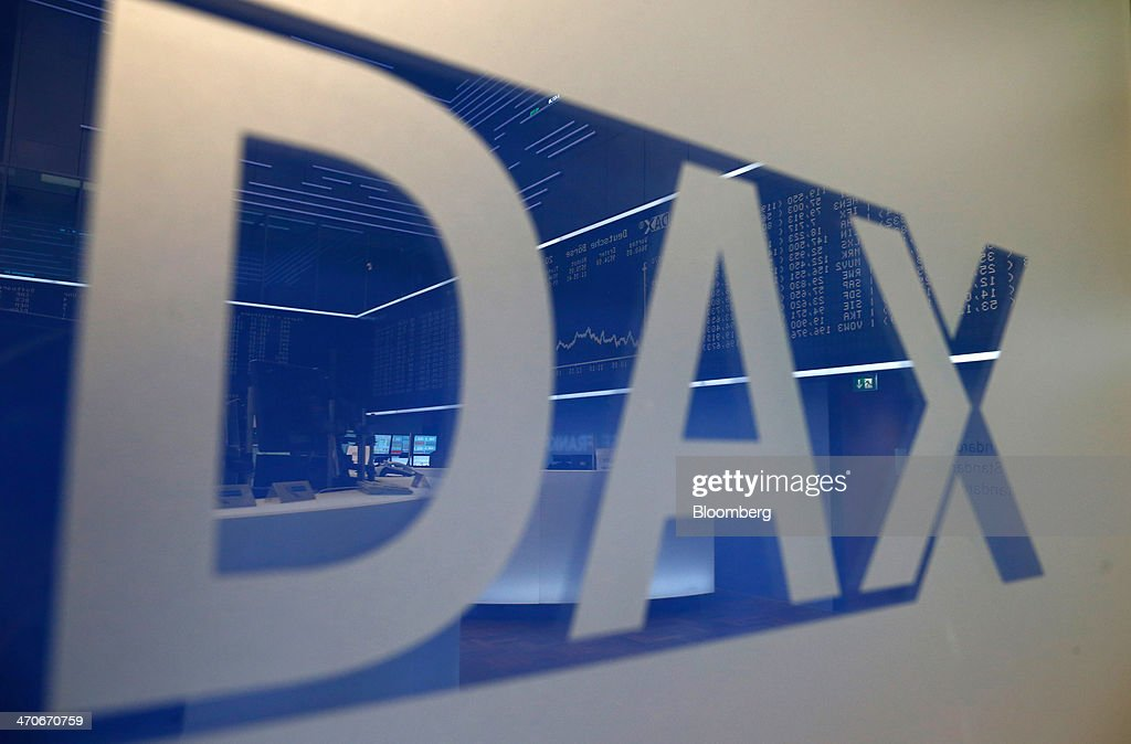 A DAX logo sits on display on the trading floor at the Frankfurt Stock Exchange in Frankfurt, Germany, on Thursday, Feb. 20, 2014. Deutsche Boerse AG plans to set up a clearinghouse in Singapore to compete with Singapore Exchange Ltd. and IntercontinentalExchange Group Inc. as the owner of the Frankfurt Stock Exchange and the Eurex futures market seeks to benefit from new financial regulations. Photographer: Ralph Orlowski/Bloomberg via Getty Images