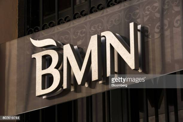 A BMN logo sits on display outside a Banco Mare Nostrum SA bank branch in Madrid on Wednesday June 28 2017 Bankia SA agreed to acquire Banco Mare...