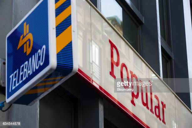 A logo sits on display outside a Banco Popular Espanol SA bank branch in Madrid Spain on Friday Feb 10 2017 Banco Populars new Chairman Emilio...